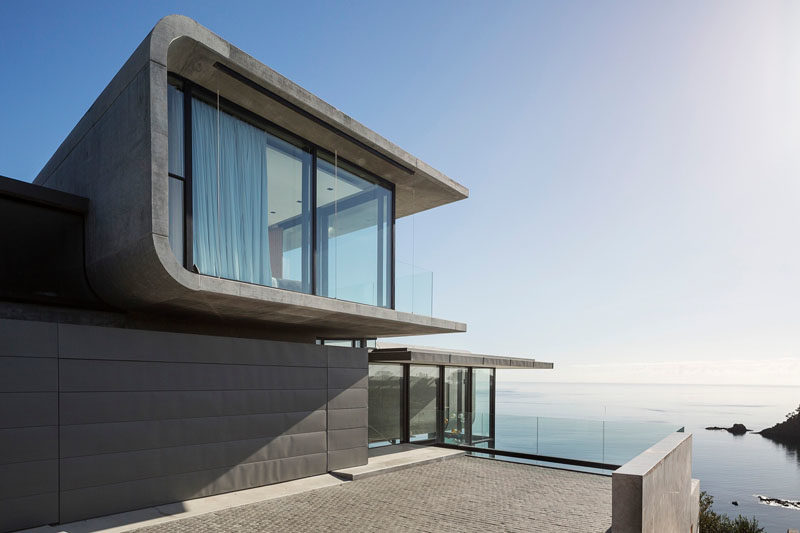 This House Sits Above A Rocky Cliff Overlooking Ocean 1